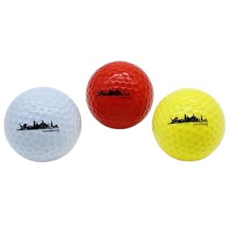 Golfbälle mit Lüneburg-Skyline